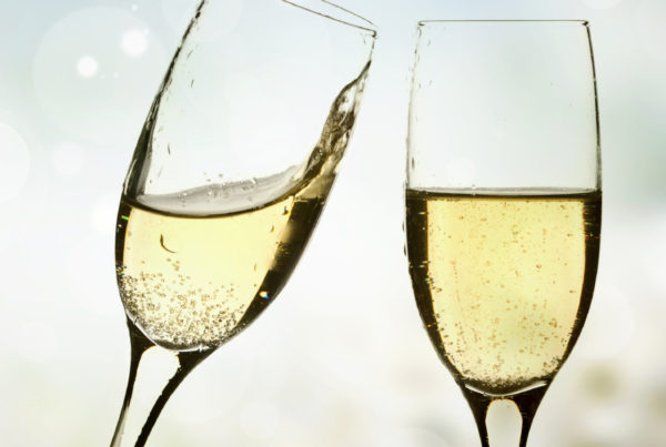 Glasses of champagne on background with blurred lights